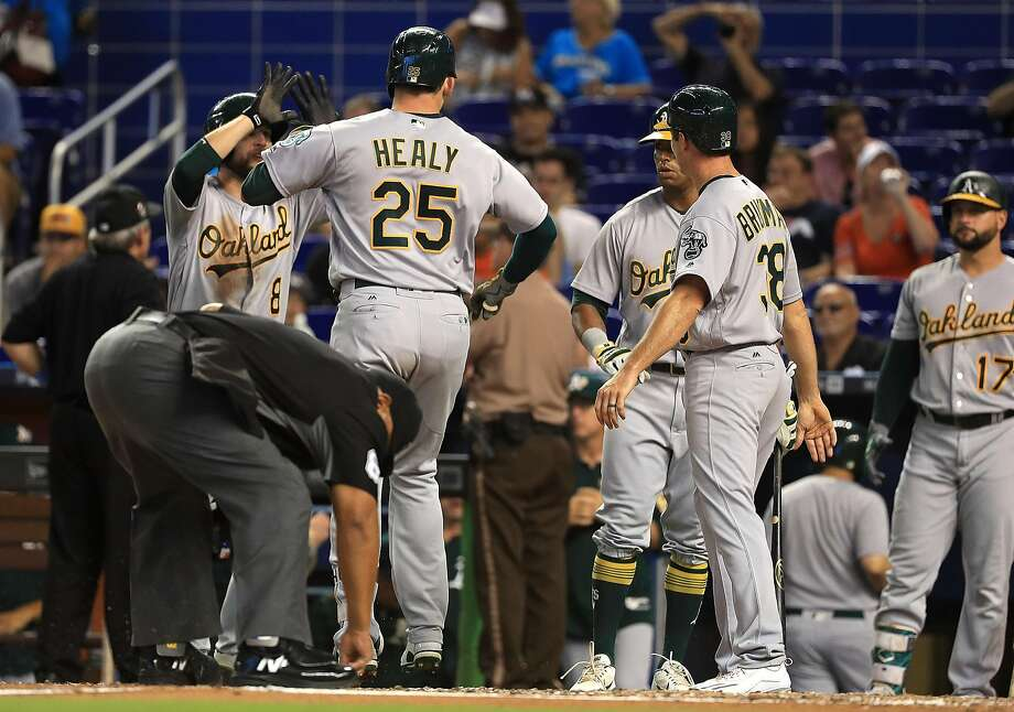 MIAMI, FL - JUNE 14:  Ryon Healy #25 of the Oakland Athletics is congratulated after hitting a three run home run during a game against the Miami Marlins at Marlins Park on June 14, 2017 in Miami, Florida.  (Photo by Mike Ehrmann/Getty Images) Photo: Mike Ehrmann, Getty Images
