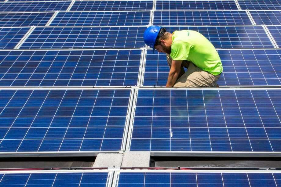 Mike Catanzaro, panel installer at Accelerate Solar, finishes installed electrical wiring at a solar array he recently installed at a job site in East Charlotte, North Carolina. Photo: Logan Cyrus / The Washington Post / THE WASHINGTON POST