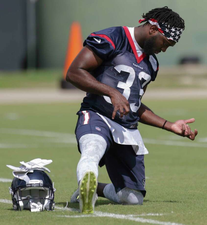 Houston Texans running back Akeem Hunt rocks air guitar while warming up at Texans minicap at Texans Practice facility Wednesday, June 14, 2017, in Houston. Photo: Yi-Chin Lee / © 2017  Houston Chronicle