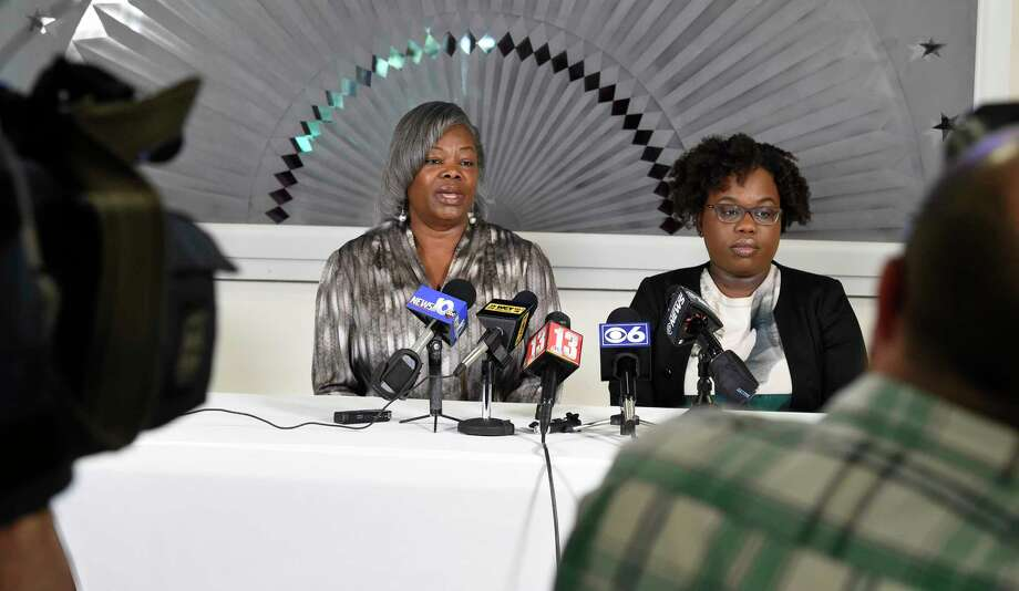 Gertha DePas, mother of Edson Thevenin who was shot by Troy Police Sgt. French, left is joined by her daughter in law Cinthia Thevenin as they spoke to the media during a press conference April 28, 2016 at the Empire Christian Center in Albany, N.Y.     (Skip Dickstein/Times Union) Photo: SKIP DICKSTEIN / 10036420A