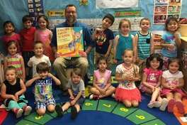 """The EdAdvance Head Start programs recently celebrated Head Start's 52nd birthday with a reading arty featuring high-profile local officials. Over 1,000 Head Start programs nationwide, including New Milford, participated in reading parties. New Milford Mayor David Gronbach, back row, helped the Northville Elementary School Head Start children celebrate by reading """"If You Take a Mouse to School"""" written by Laura Numeroff. Students are, from left to right, in front, Grace D'Addario, Jayden Reid, Michael Martirano, Zoe Cevallos-Diaz, Skyann Kv, Kvale, Grace Kwok and Sarita Garzon; second row, Sonya Hyde and Niko Fox; and in back, Diana Auquilla, Giovanni Martirano, Alys Hyde. Dylan Anderson, Ryleigh Robinson-Lisee, Spencer Woolley and Maria Fernanda Ortega-Romano."""