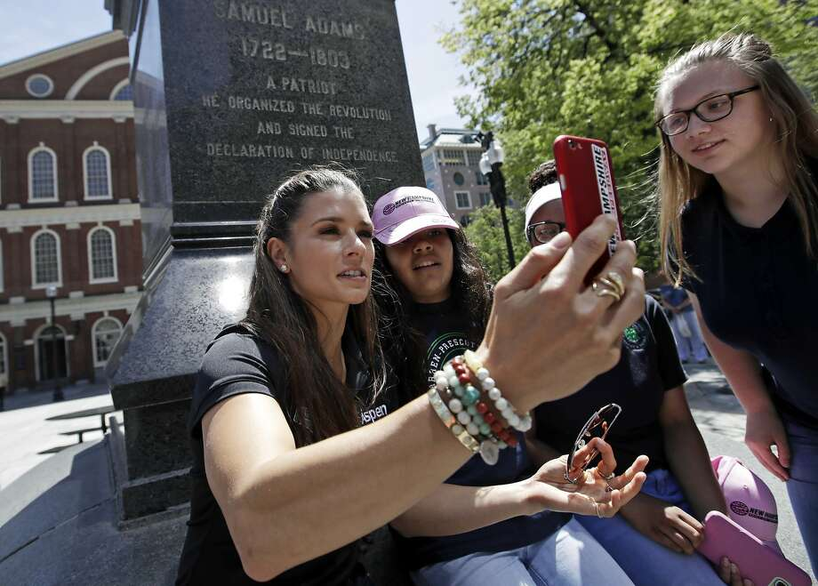 "NASCAR driver Danica Patrick, left, shoots selfies with students from the Warren-Prescott school at Faneuil Hall during a tour of historic sites, Wednesday, June 14, 2017, in Boston. Patrick says she ""had a moment"" when she lost her temper at a booing fan after qualifying for last week's NASCAR race. (AP Photo/Elise Amendola) Photo: Elise Amendola, Associated Press"