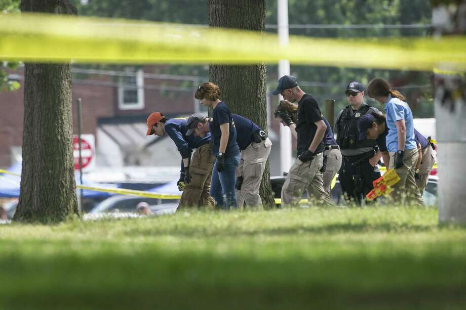 FBI Evidence Response Team members document the scene at Eugene Simpson Stadium Park following a shooting in Alexandria, Va., June 14, 2017. The shooting, at a baseball field where members of a congressional team regularly practice, left five injured, including House Majority Whip Steve Scalise of Louisiana, police said. Photo: AL DRAGO /NYT / NYTNS
