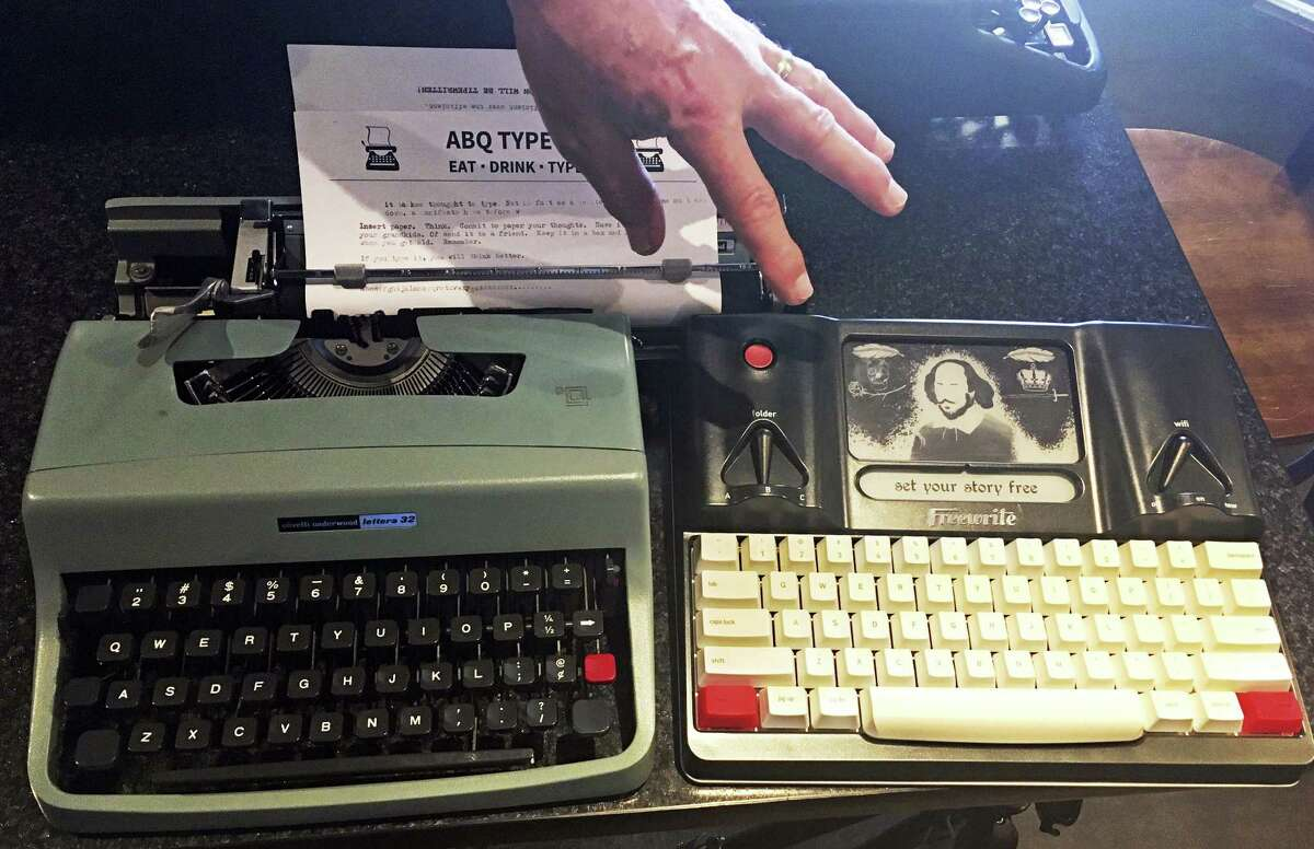 A 1964 Olivetti Lettera 32 and a Freewrite - a modern, smart typewriter that sends typed documents to the cloud - are on display at a