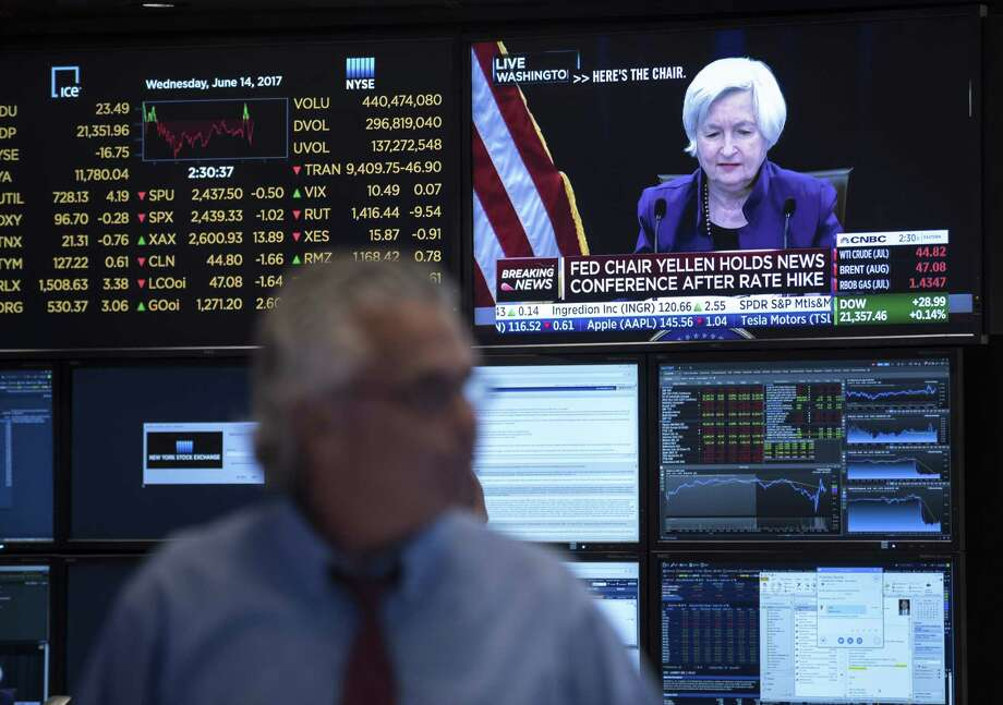 NEW YORK, NY - JUNE 14:  Traders work as a television monitor displays Federal Reserve Chair Janet Yellen announcing the Fed's decision to raise interest rates on the floor of the New York Stock Exchange (NYSE) June 14, 2017 in New York City. The Federal Reserved raised interest rates today .25 percent  for a new target range of 1 percent to 1.25 percent. Photo: Drew Angerer, Getty Images / 2017 Getty Images
