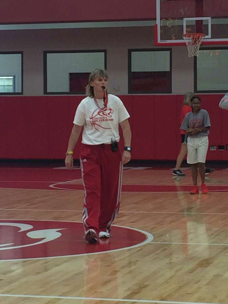 Coach Michelle Trotter runs a drill during the Crosby High School girls basketball youth camp on June 13. Erica Smith, a member of the Crosby Cougar girls basketball team and class of 2017, background, helped put on the camp.