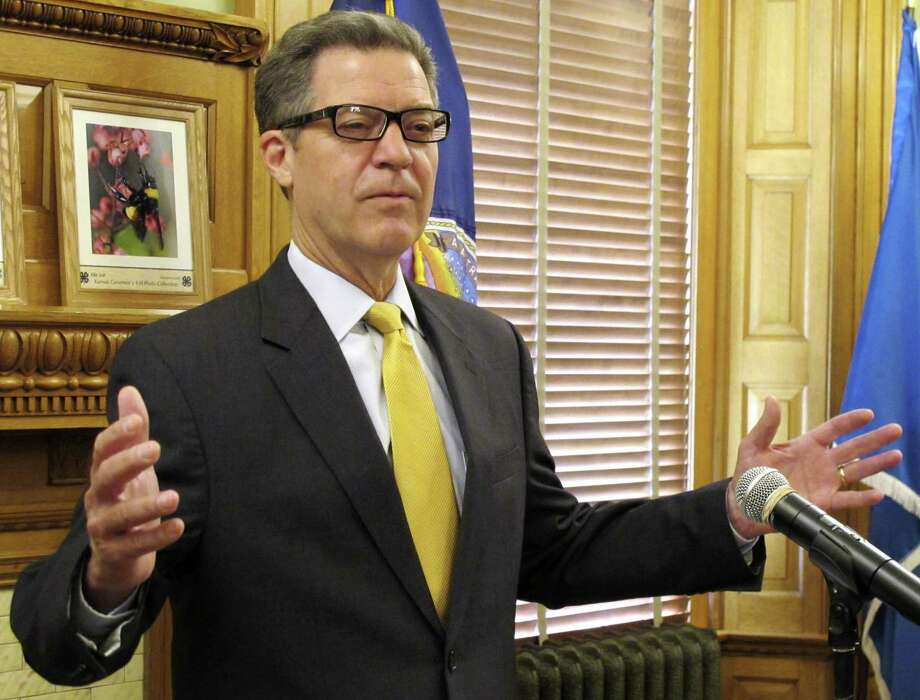 Kansas Gov. Sam Brownback imposed GOP orthodoxy — cutting taxes, shrinking government — and the state suffered grievously. Last week, the state Legislature restored many of the taxes. Photo: John Hanna /Associated Press / Copyright 2017 The Associated Press. All rights reserved.