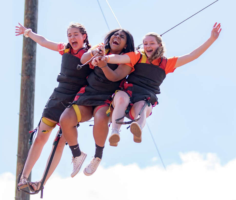 Campers take a turn on the giant swing during Stonegate Fellowship's summer camp in Glorieta, NM.  Photo by Dallas Daley Photo: Dallas Daley