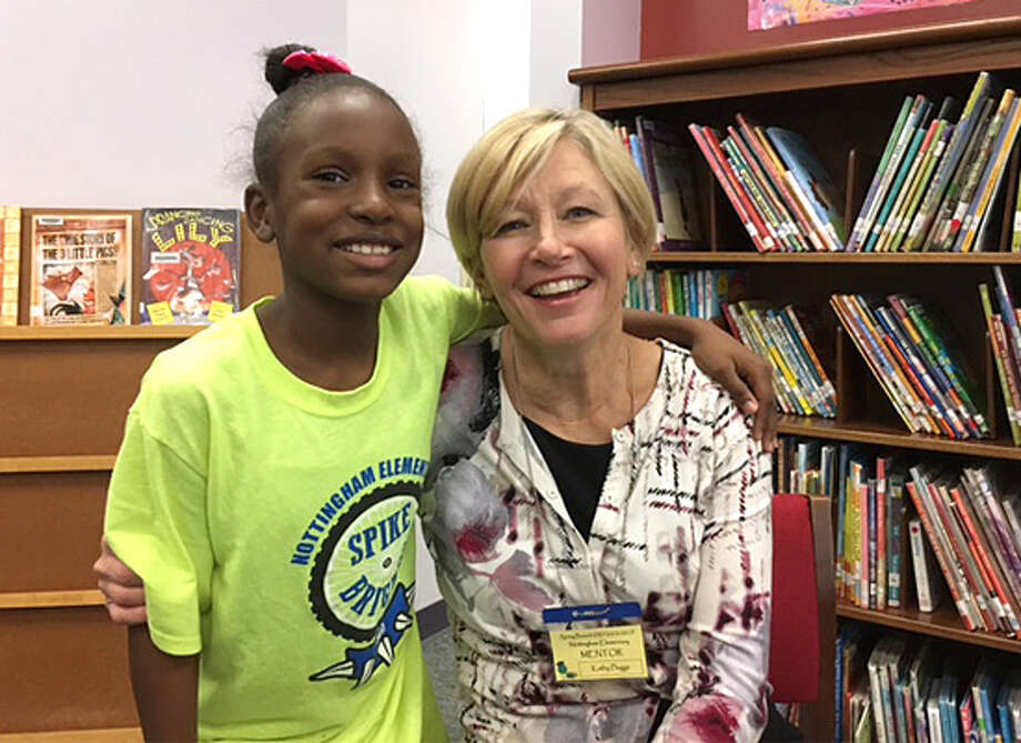 Spring Branch ISD mentor Kathy Plugge takes a moment with mentee Tira. Photo: Spring Branch ISD