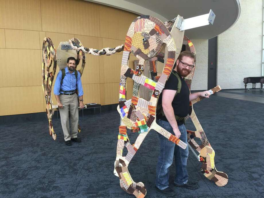 Actors Linford Herschberger (left) and Kurt Bilanoski practice walking around in the back and front parts of Aslan the lion. This is the first time A.D. Players has incorporated puppetry of this size for a play. Photo: Rebecca Hazen