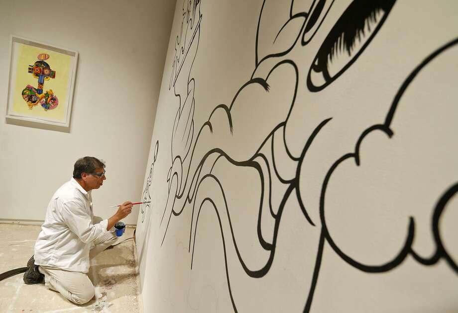 """John A. Hernandez work on his mural """"Octopus's Garden,"""" part of the """"Daydreams and Other Monsters"""" at the UTSA Main Gallery. Photo: Edward A. Ornelas /San Antonio Express-News / © 2017 San Antonio Express-News"""