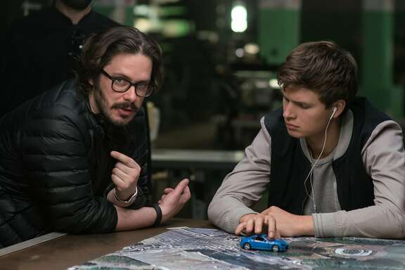 "Writer-director Edgar Wright and actor Ansel Elgort on the set of the new car chase-musical ""Baby Driver""."