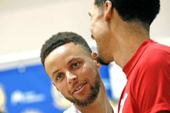 Golden State Warriors' Stephen Curry and Shaun Livingston during media availability at the Warriors' practice facility in Oakland, Calif., on Wednesday, June 14, 2017.