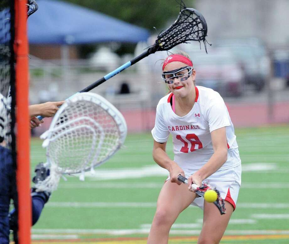 At right, Genevieve DeWinter of Greenwich scores a goal during the CIAC Class L girls high school lacrosse semifinal match between Greenwich High School and Wilton High School at Brien McMahon High School in Norwalk, Conn., Tuesday, June 6, 2017. Wilton advanced with a 14-8 victory over Greenwich. Photo: Bob Luckey Jr. / Hearst Connecticut Media / Greenwich Time