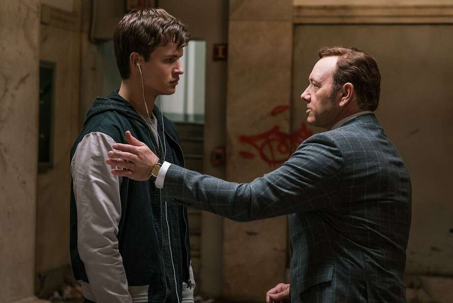 "Ansel Elgort (left) plays a young getaway driver and Kevin Spacey a crime boss in ""Baby Driver."" Photo: Tri-Star Pictures"
