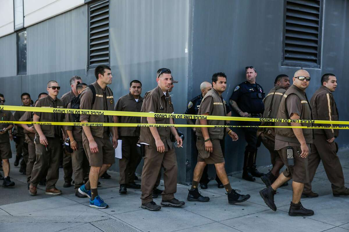 UPS workers evacuate their building at the scene of an active shooting at 16th Street and Utah Street in San Francisco, California, on Wednesday, June 14, 2017.