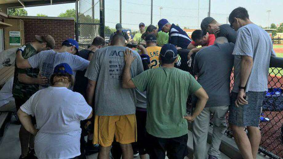 Members of the Democratic Congressional Baseball Team baseball prays for House Majority Whip Steve Scalise, who was shot on June 14, 2017. The shooting happened at the final practice tune-up for the Republican team in Alexandria, Va., Photo: U.S. Rep. Ruben Kihuen Of Nevada's 4th Congressional District / Contributed Photo / Connecticut Post