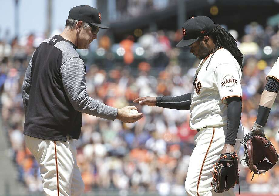 Giants pitcher Johnny Cueto hands the ball to Bruce Bochy as he is relieved during the sixth inning of a baseball game against the Kansas City Royals in San Francisco, Wednesday, June 14, 2017. Photo: Jeff Chiu, Associated Press