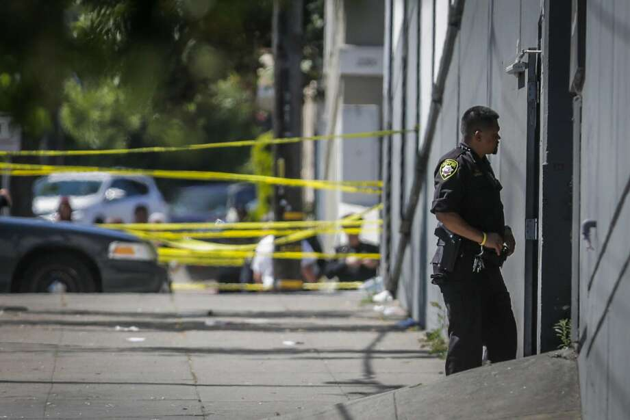 A police officer stands guard outside of a UPS facility on San Bruno Avenue at the scene of a shooting in San Francisco. Photo: Gabrielle Lurie, The Chronicle