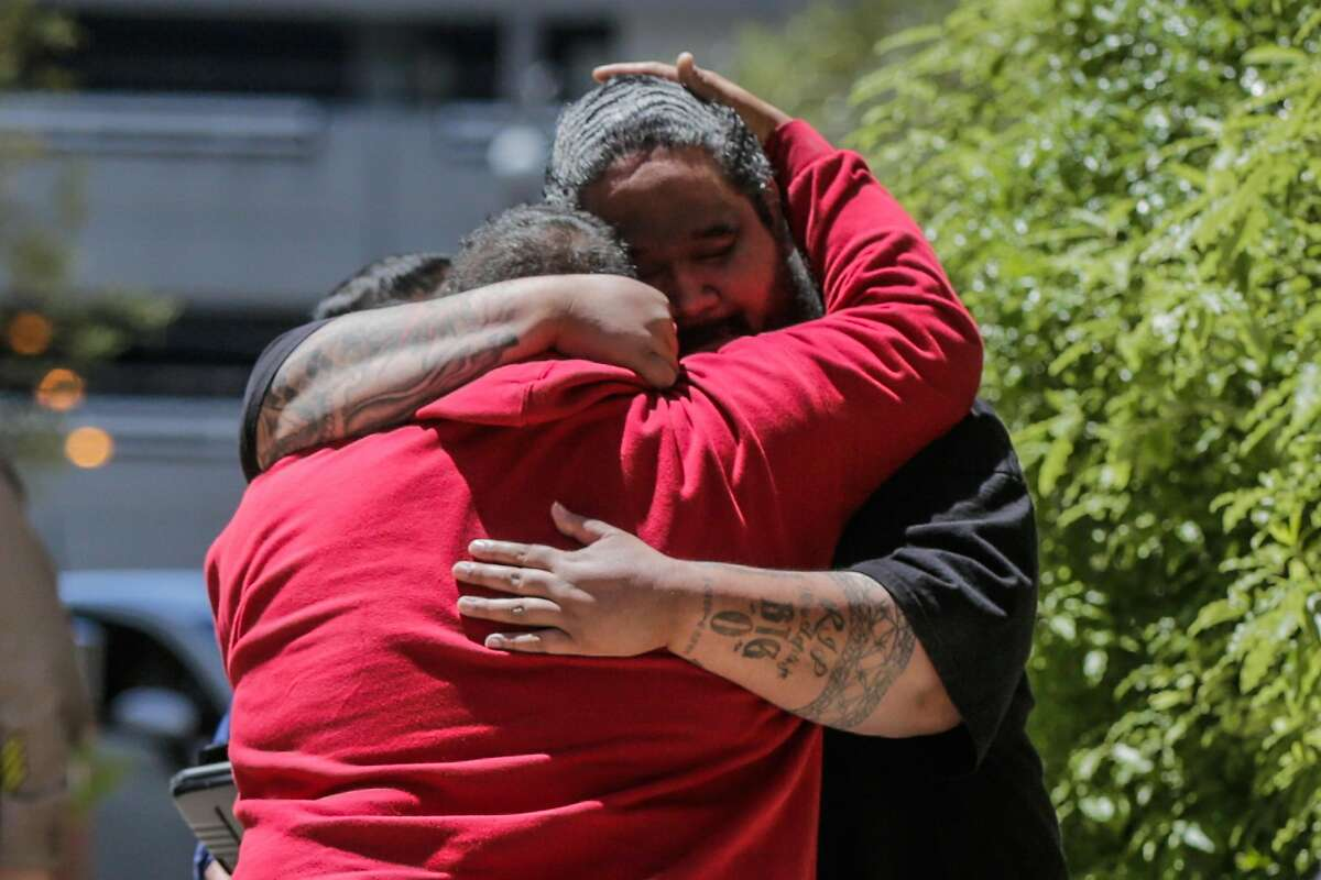 People embrace at San Francisco General Hospital following an active shooting in Potrero Hill in San Francisco on Wednesday, June 14, 2017. The people are said to be related to a victim of the shooting.
