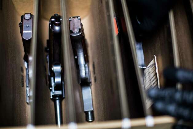 Jose Falcon, a National Integrated Ballistic Information Network (NIBIN) Technician for Houston Forensic Science Center, shows the firearms on file at the facilities specifically the Firearm's section of the lab, Tuesday, April 18, 2017, in Houston. Photo: Marie D. De Jesus, Houston Chronicle / © 2017 Houston Chronicle