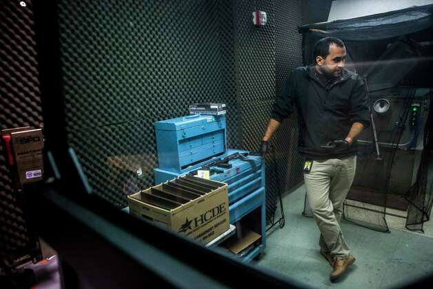 Jose Falcon, a National Integrated Ballistic Information Network (NIBIN) Technician for Houston Forensic Science Center demonstrates the different firearms kept at the facilities specifically the Firearm's section of the lab, Tuesday, April 18, 2017, in Houston. Photo: Marie D. De Jesus, Houston Chronicle / © 2017 Houston Chronicle