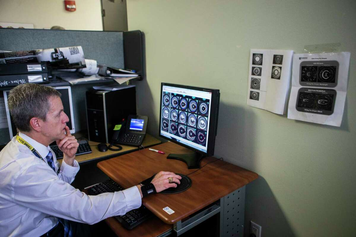Darrell Stein the Houston Forensic Science Center Firearms Section manager, demonstrates the a federal database known as the National Integrated Ballistics Identification Network used to track guns being used in violent crime by comparing matches with a bullet casing, Tuesday, April 18, 2017, in Houston.