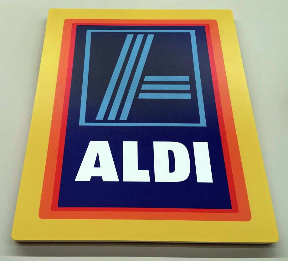 This June 5, 2017, photo, shows signage at an Aldi food market, in Salem, N.H. Discounter Aldi, one of the no-frills European chains that offer low prices but far fewer options, and mostly its own brands, is putting the pressure on traditional grocers. Aldi expects to have 2,500 U.S. stores by the end of 2022. (AP Photo/Elise Amendola) Photo: Elise Amendola, STF / Copyright 2017 The Associated Press. All rights reserved.