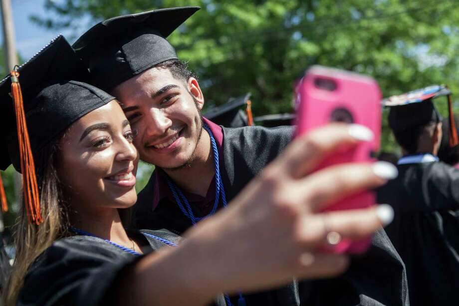 Chastity Calderon makes a selfie with Gerson Carrillo before the Bullard-Havens Technical High School commencement ceremony, which was held at Klein Memorial Auditorium in Bridgeport, Conn. on Wednesday, June 14, 2017. Photo: Johnathon Henninger, For Hearst Connecticut Media / Connecticut Post Freelance