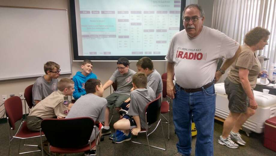A group of Boy Scouts earn their Radio Merit Badge during a past Field Day event. Photo: Courtesy Of TEAC.net