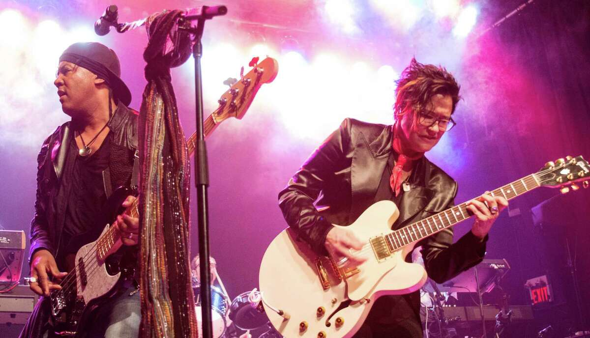 When he takes the stage with his band mates, Revolution bassist Brown Mark (left) hopes fans will experience what it was like to be near Prince with a high-energy, powerful set.