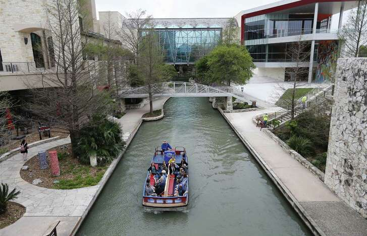 A river barge takes people on a guided tour along the River Walk on Mar. 16, 2017.