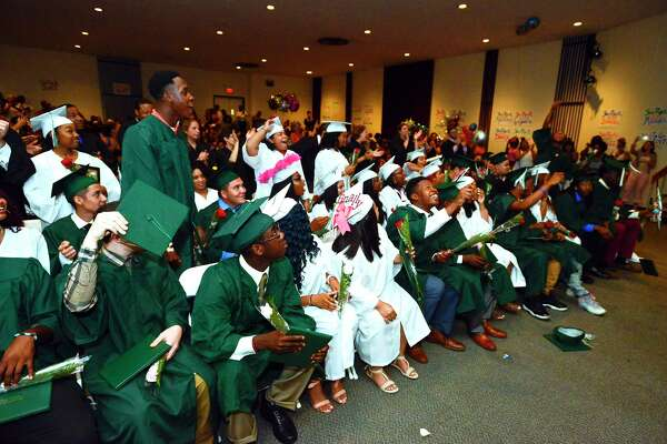 Stamford Academy Class of 2017 celebrate graduating and receiving their diplomas in a ceremony at Trailblazers Academy in Stamford, Conn., on Wednesday, June 14, 2017.