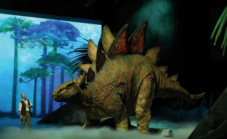 """Walking With Dinosaurs,'' a live spectacular roaring into the Arena at Harbor Yard in Bridgeport on Tuesday and Wednesday. Photo: Contributed Photo / CT POST"