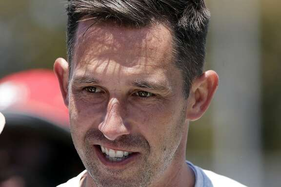 San Francisco 49ers head coach Kyle Shanahan smiles during NFL football practice at the team's training facility Tuesday, June 13, 2017, in Santa Clara, Calif. (AP Photo/Marcio Jose Sanchez)