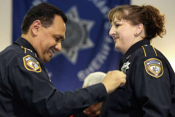 Harris County Sheriff Ed Gonzalez puts the new badge onto HCSO Detention Deputy Candidate Colleen Peake during the graduation ceremony at HCSO Training Academy Wednesday, June 14, 2017, in Humble. Sheriff Gonzalez has reinstated the Detention Deputy program and this class had 63 graduating deputies.
