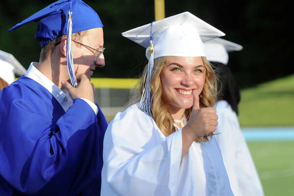 Carly Horch gestures to the crowd during Commencement for the Frank Scott Bunnell High School Class of 2017, in Stratford, Conn. June 14, 2017.
