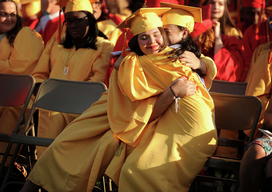 Friends Martha Polanco, left, and Angeleen Pingol share a hug during the Stratford High School graduation at Penders Field in Stratford, Conn on June 14, 2017. Photo: Brian A. Pounds, Hearst Connecticut Media / Connecticut Post