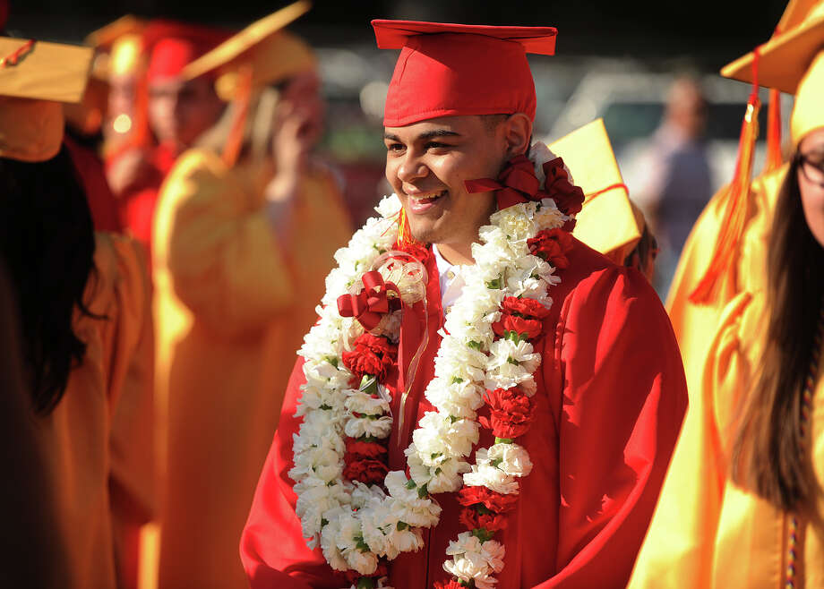 Graduate Kimo Hensley wears flower leis in tradition of his Hawaiian heritage for the Stratford High School graduation ceremony at Penders Field in Stratford, Conn on June 14, 2017. Photo: Brian A. Pounds, Hearst Connecticut Media / Connecticut Post