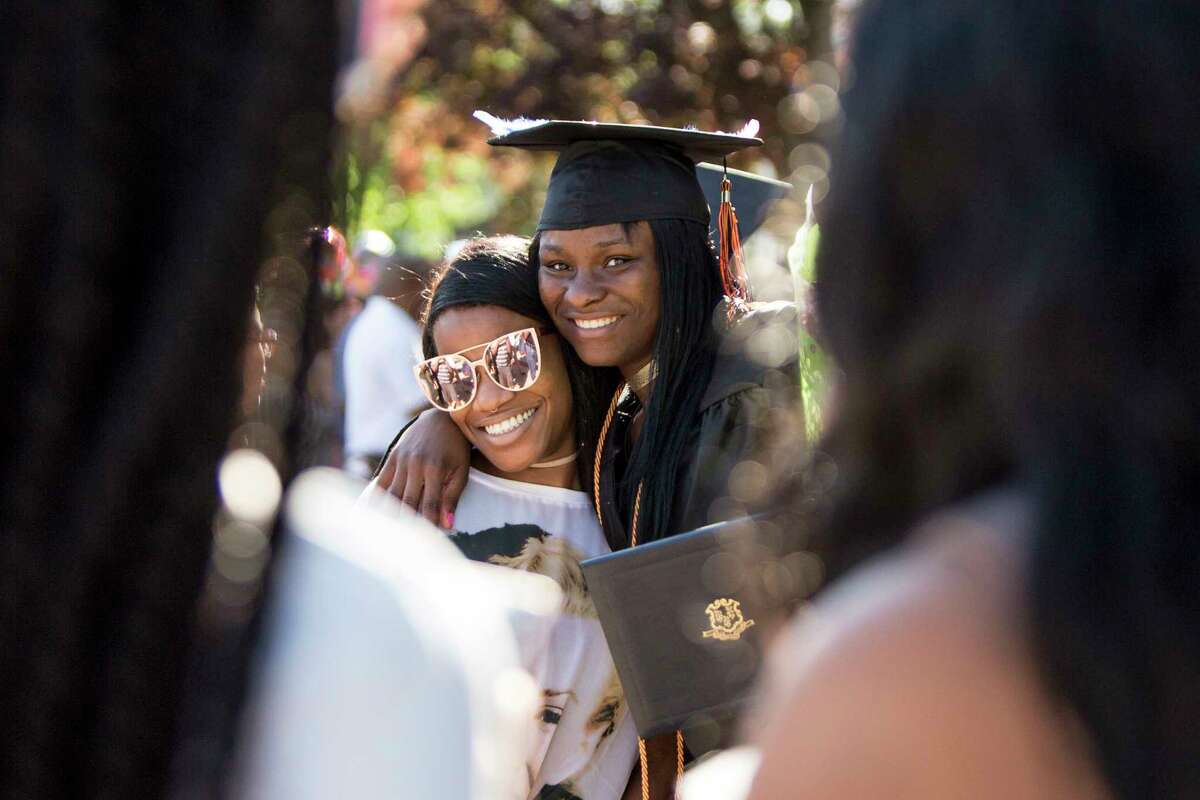 Righche Reddice right, poses with her cousin, Kiara Brown, left after The Bullard-Havens Technical High School commencement ceremony, which was held at Klein Memorial Auditorium in Bridgeport, Conn. on Wednesday, June 14, 2017.