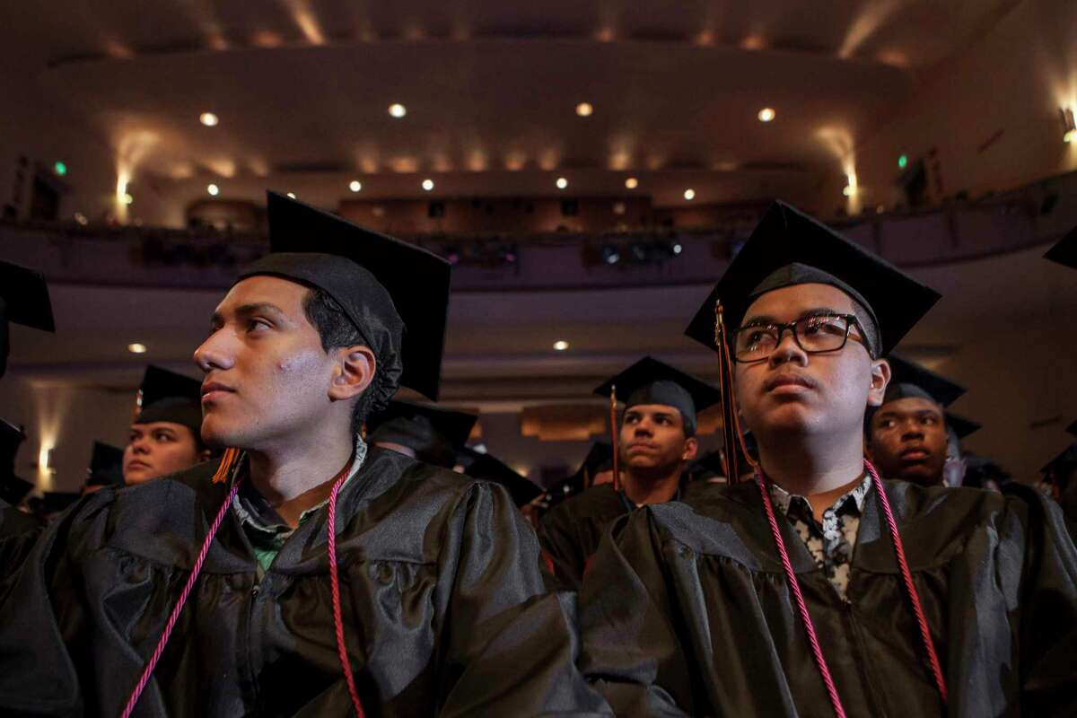 Aaron Ruiz, left, sits with classmate, Stefon Sinn, right, listening to the commencement speaker during The Bullard-Havens Technical High School commencement ceremony at Klein Memorial Auditorium in Bridgeport, Conn. on Wednesday, June 14, 2017.