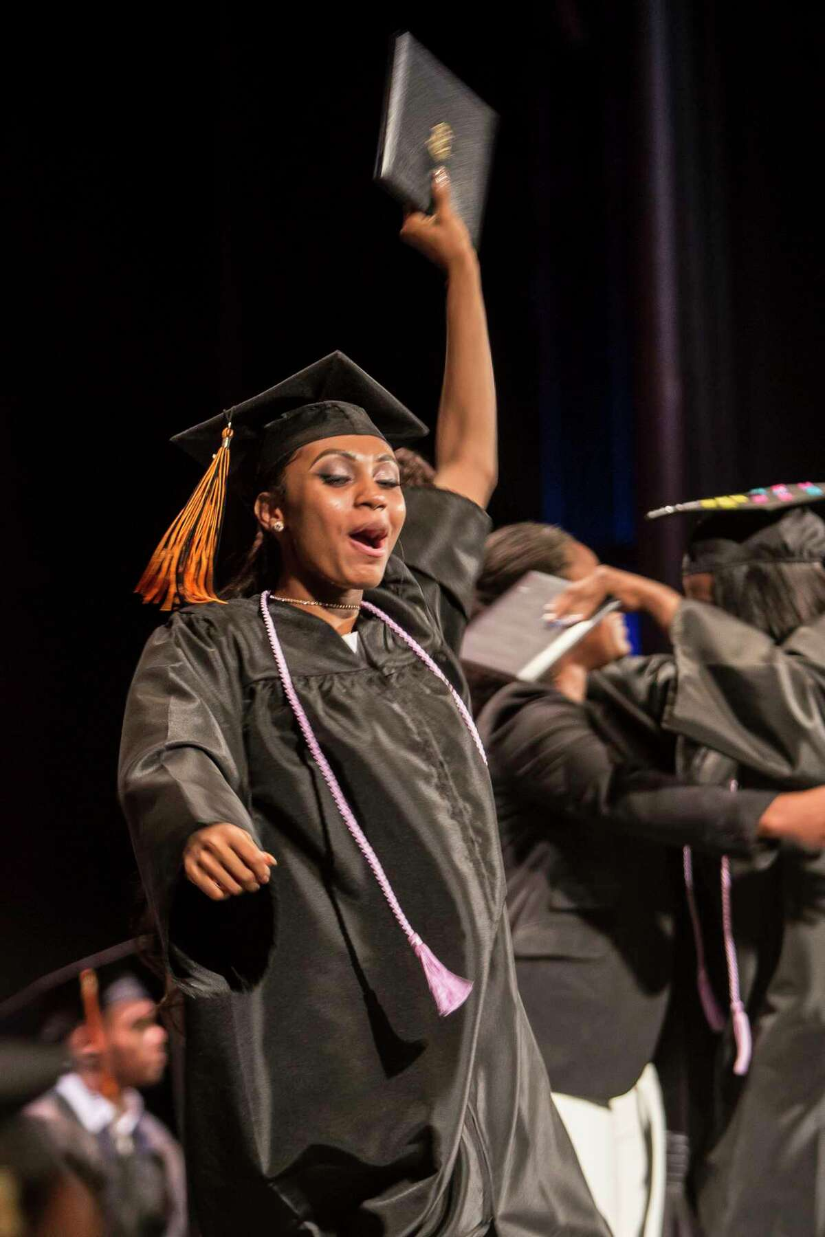 Lamonie Baldwin raises her diploma high after it was handed to her on stage at The Bullard-Havens Technical High School commencement ceremony. Klein Memorial Auditorium hosted the event in Bridgeport, Conn. on Wednesday, June 14, 2017.