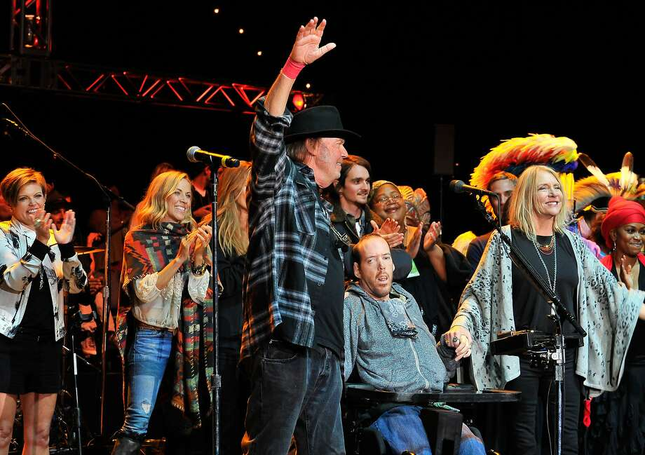 From left to right, Natalie Maines of Dixie Chicks, Sheryl Crow, Neil Young, Ben Young and Pegi Young at the 29th Annual Bridge School Benefit concert at Shoreline Amphitheatre on October 25, 2015 in Mountain View, California. Photo: Steve Jennings