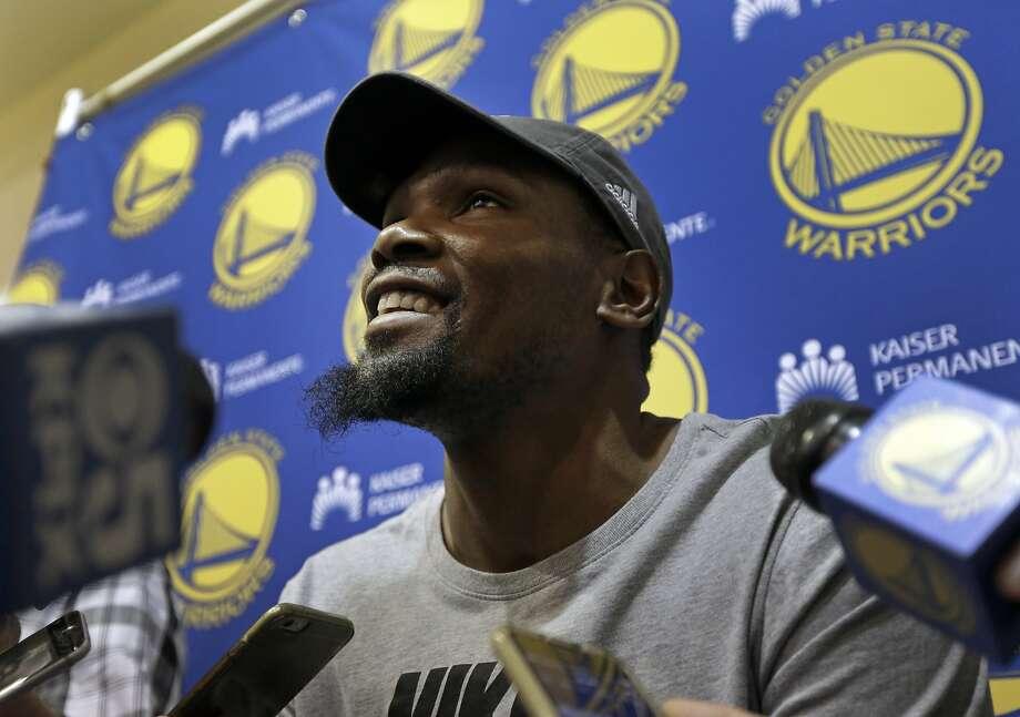 Golden State Warriors' Kevin Durant smiles during an NBA basketball news conference on Wednesday, June 14, 2017, in Oakland, Calif. (AP Photo/Ben Margot) Photo: Ben Margot, Associated Press