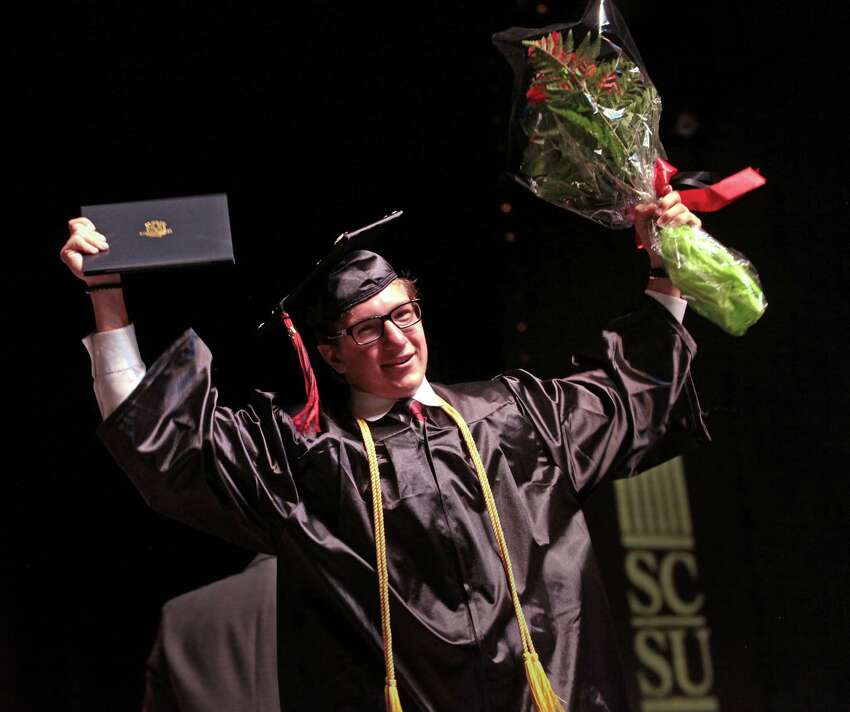 Jon Pedersen, of Milford, celebrates after receiving his diploma at the Platt Technical High School commencement ceremony at SCSU Lyman Hall in New Haven, Conn. on Wednesday, June 14, 2017.