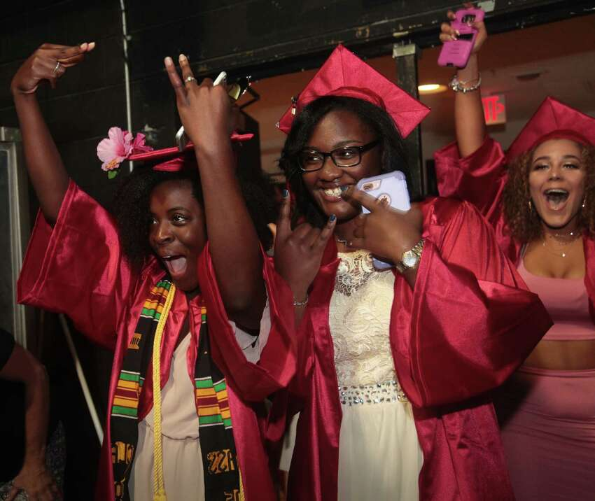 Davina Robinson, of Ansonia, left, and Krystal Aidoo, of Derby, center, and Kayla Cotto of Milford, celebrate at the Platt Technical High School commencement ceremony at SCSU Lyman Hall in New Haven, Conn. on Wednesday, June 14, 2017.