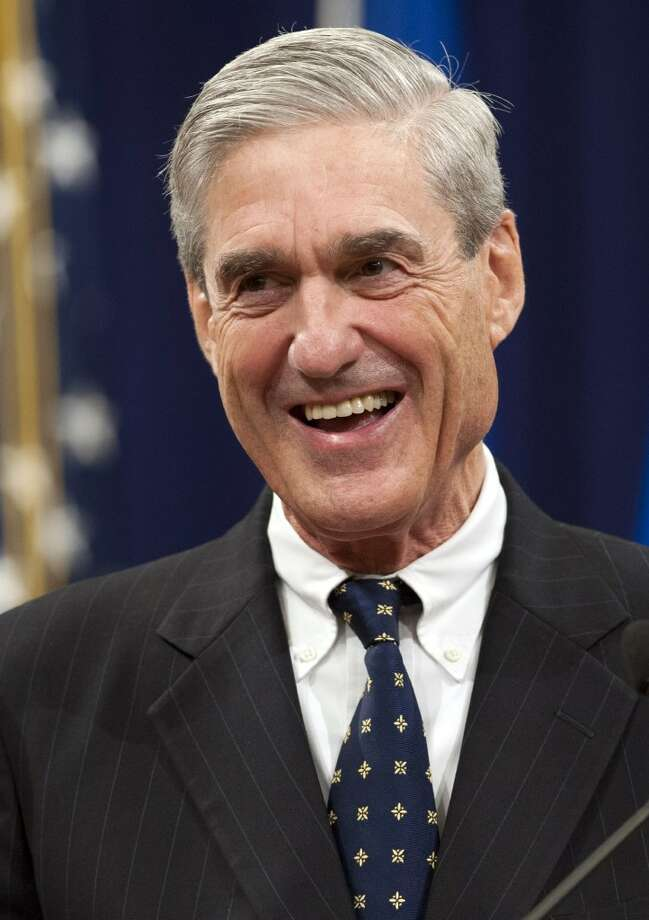 This file photo taken on August 1, 2013, shows Federal Bureau of Investigation (FBI) Director Robert Mueller during a farewell ceremony in his honor at the Department of Justice in Washington, DC.  Saul Loeb/AFP/Getty Images