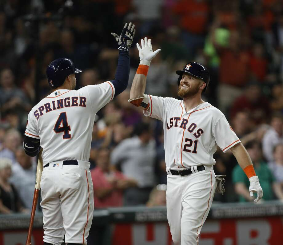 Houston Astros Derek Fisher (21) celebrates his first home run with George Springer (4) during the sixth inning of an MLB game at Minute Maid Park, Wednesday, June, 14, 2017.   ( Karen Warren / Houston Chronicle ) Photo: Karen Warren/Houston Chronicle