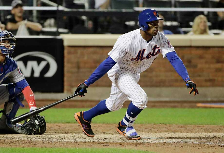 New York Mets' Curtis Granderson watches his home run during the eighth inning of the team's baseball game against the Chicago Cubs on Wednesday, June 14, 2017, in New York. (AP Photo/Frank Franklin II) ORG XMIT: NYM115 Photo: Frank Franklin II / Copyright 2017 The Associated Press. All rights reserved.