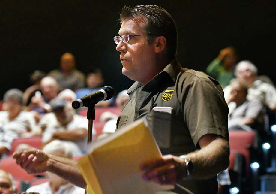 Mark Greene, a UPS driver from Kingston, questions U.S. Treasury officials Robert Neis and Janet Laufer during a town hall about the looming pension cuts for teamsters Wednesday June 14, 2017 in Albany, NY.  (John Carl D'Annibale / Times Union) Photo: John Carl D'Annibale / 20040789A